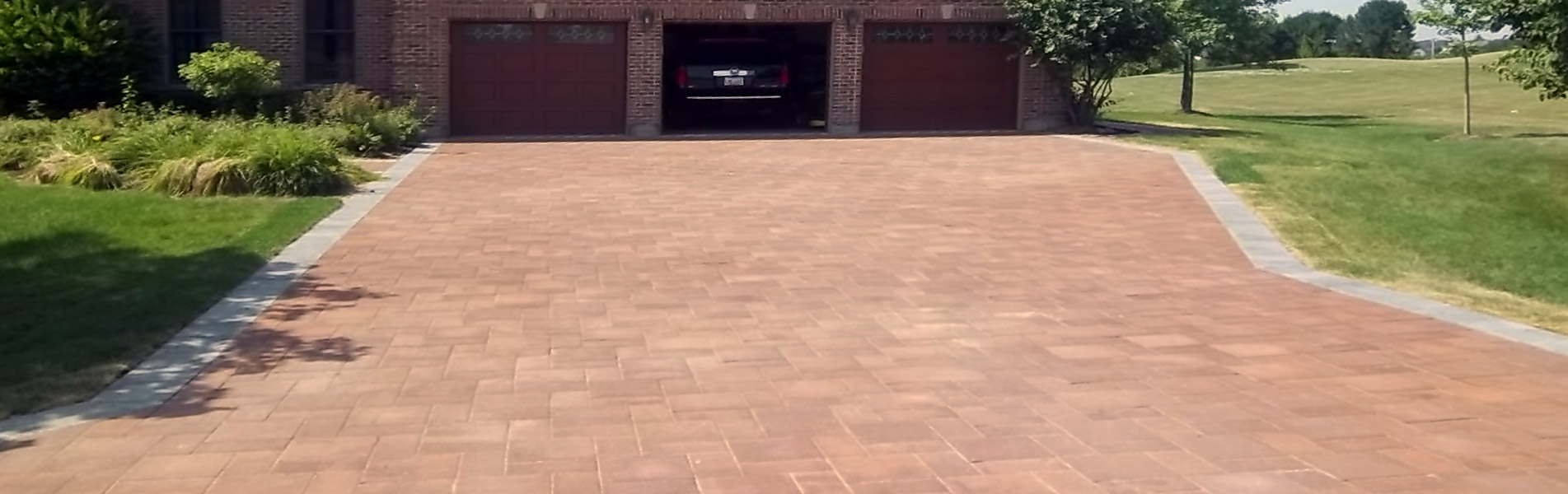Custom Brick Driveway Installation Services by B&C Pavers and Landscaping Inc.